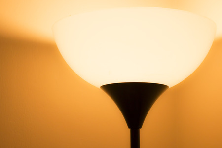 floor lamp: Warm light from floor lamp Stock Photo