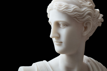 White head marble statue of roman Ceres or greek Demeter isolated on black Stock Photo