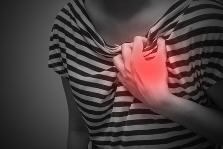 Sick woman with severe heartache, suffering from chest pain
