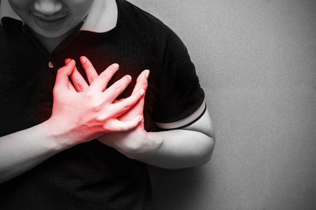 A man with severe heartache, suffering from chest pain