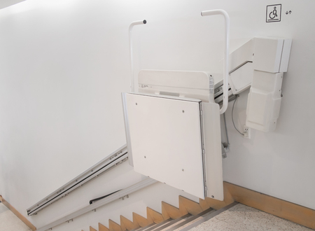 Stairlift on staircase for elderly people in a building