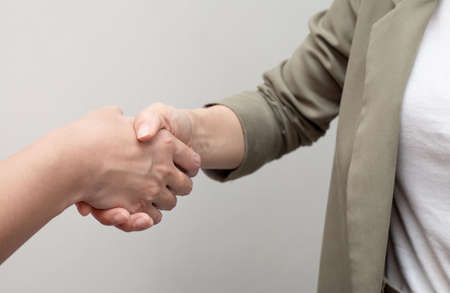 Woman in suit shake hand as negotiation business, greet or thanks gesture Stockfoto