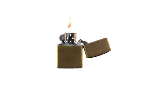 Golden brass metal gasoline lighter with fire. isolated on white