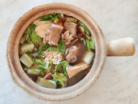 Bak kut teh serving in clay pot, a pork rib dish cooked in broth popularly served in Malaysia and Singapore