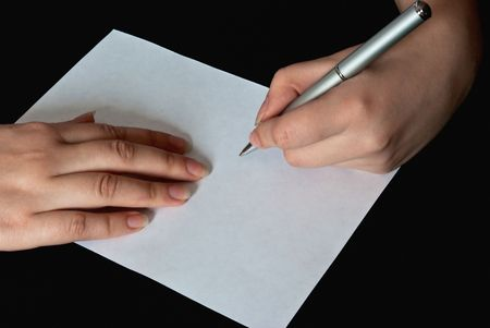 left hand: closeup view of left hand of a woman writing on a blank sheet of paper with a pen