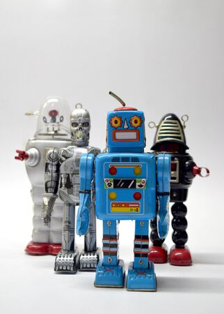 economic revival: Robot team vintage toy close up