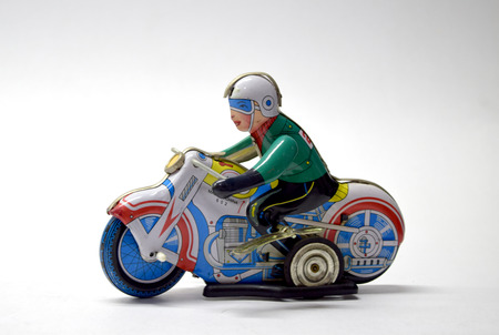economic revival: motorbike vintage toy close up Stock Photo