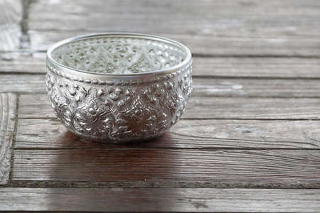 silver bowl handicrafts on table