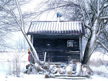 A true shack in winter with snow covered roof