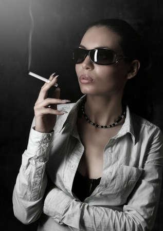 Glamour Girl Smoking on the Dark background