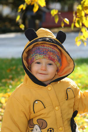 insipid: Smiling boy on autumn nature Stock Photo