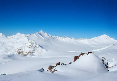 Snowy Mountains on morning time with blue sky photo