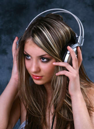 Blond Girl with silver Headphones Stock Photo - 850996