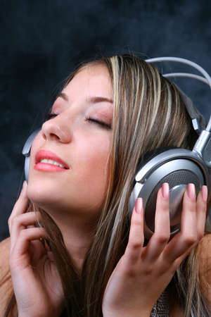 Blond Girl with silver Headphones Stock Photo