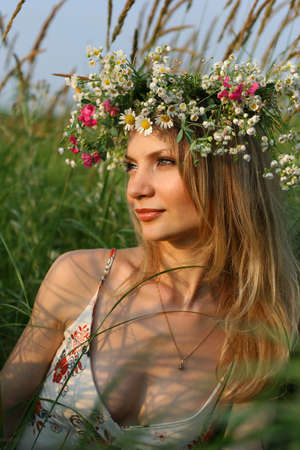 Beauty blond girl with wild flowers photo