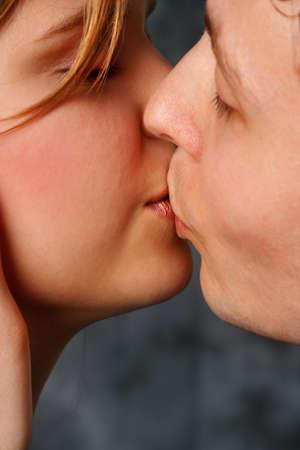 Beautiful couple kissing lips to lips