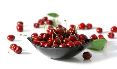 Dish of red and yellow cherries photo
