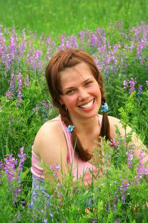 Smiley Beauty Russian Girl in green meadow