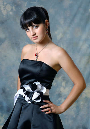 Beautiful Brunette Girl with in black dress