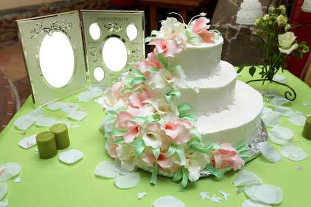 Wedding Cake over green table Stock Photo