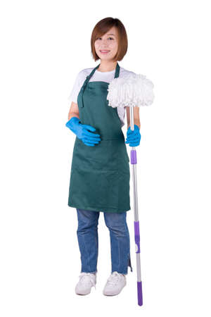 Young Asian housewife holding mop stand on white background Stock Photo