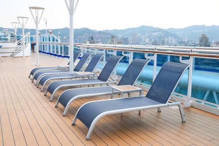 Beach chairs on the deck Фото со стока