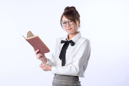 A cute girl student hold an opened book