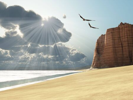 Sunlight shines down on two birds flying near a cliff by the ocean. Stock Photo