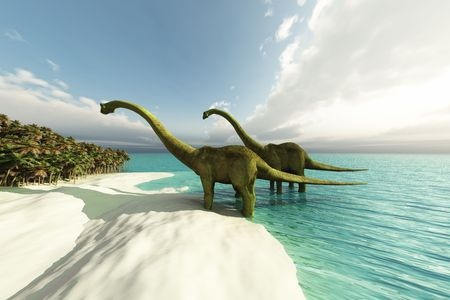 Two Diplodocus dinosaurs wade is shallow waters of a white sand beach. Stock Photo