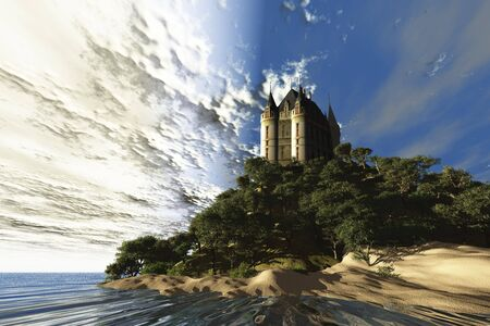 A beautiful castle sits majestically on a hill overlooking the ocean. Stock Photo