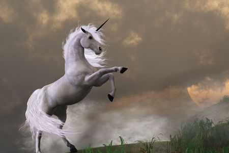 asserts: RARE EARTH - A unicorn stag asserts its power on a hill shrouded in clouds. Stock Photo