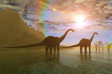 DAWN OF THE DINOSAURS - Two Diplodocus dinosaurs wade through shallow water to eat some vegetation.