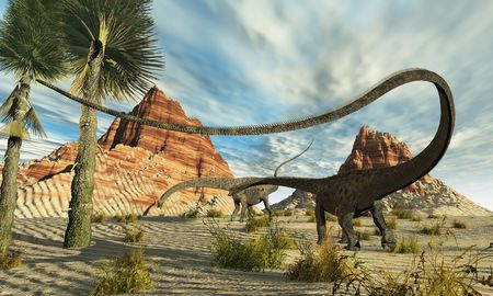 Two Diplodocus dinosaurs search for food in a desert landscape. Imagens