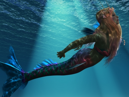 woman underwater: Mermaid of the Sea - Ocean light illuminates a magical mermaid as she swims up to the ocean surface