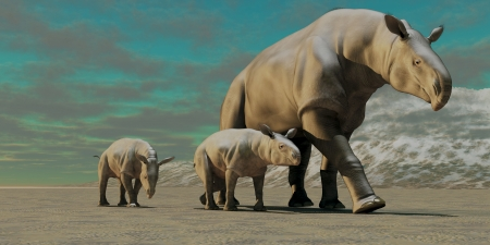 behemoth: Paraceratherium Mother - A rhinoceros-like Paraceratherium mother with two twin calves walks along a stony desert in the Oilgocene Era