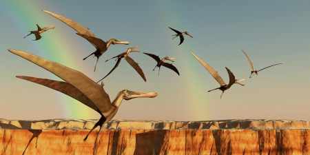 extinction: Pterodactyl - A flock of Pterodactyls fly out of a canyon looking for new prey to eat  Stock Photo