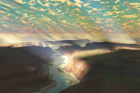 canyon: Canyon Landscape - Sunrays shine down on mist hovering over a canyon river in a desert wilderness.
