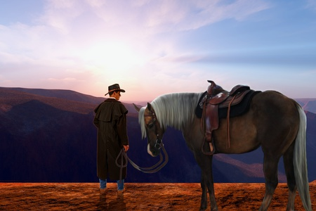 high plateau: Daybreak - A cowboy stands on a high plateau with his cow pony just as the sun rises on a new day