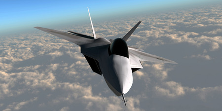 F22 Fighter Jet - An F-22 fighter jet flies at an altitude above the cloud layer on its mission Stock Photo