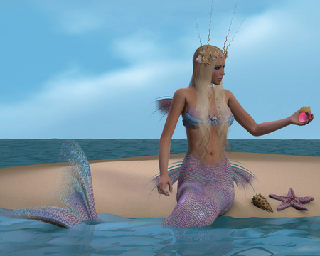 Mermaid and Seashells - A mermaid sits of a beach and admires the seashells and starfish she has collected. photo