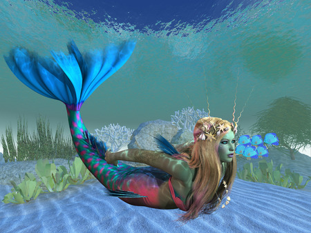 tail: Undersea Mermaid - A beautiful multi-colored mermaid swims effortlessly in clear ocean waters. Stock Photo