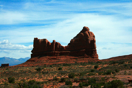 moab: Courthouse Rock in Arches National Park - Courthouse Rock towers over the desert sands and scrubland at Arches National Park near Moab Utah, USA.