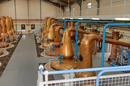 A Large room with some whisky copper stills