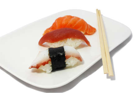 saki: saki sushi and sticks on the plate isolated