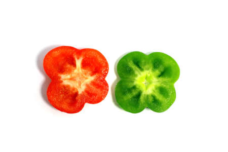 half cut: cut green and red peppers in the shape fo flowres isolated Stock Photo
