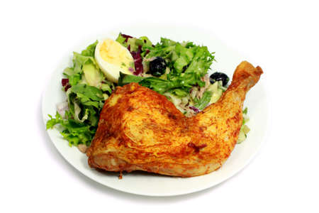 delicious fried chicken with salad and boiled egg photo