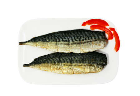halfs of smoked mackerel on the plate isolated photo