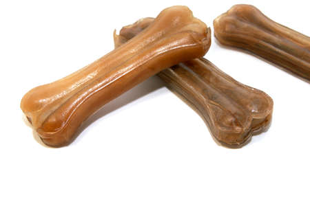 chew over: dogs pressed chew bones made of rawhide over white