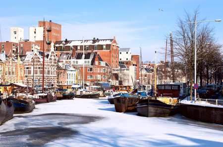 view on white channel covered with snow in Groningen, Netherlands