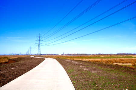 road for bikes in the Netherlands and high-voltage line Stock Photo